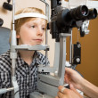Boy Having His Eyes Examined With Slit Lamp By Doctor — Stok fotoğraf