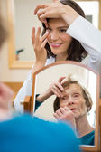 Optometrist Teaching Senior Woman To Insert Contact Lens — Stock Photo