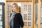 Woman Standing In Glasses Store — Stock Photo