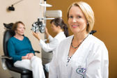Confident Eye Doctor With Colleague Examining Patient — Stock Photo