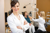 Eye Specialist With Colleague Examining Patient — Stock Photo