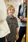 Smiling Boy Wearing Glasses In Store — Foto Stock