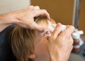 Optometrist Hands Putting Eye Drops In Patients Eye — Stock Photo