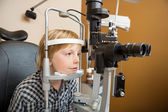 Boy Undergoing Eye Examination With Slit Lamp — Stock Photo