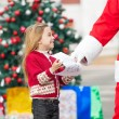 SantClaus Taking Wish List From Girl — Stock Photo #35258001