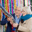 Couple Selecting Tinsels At Store — Stockfoto