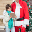 Boy Showing Digital Tablet To SantClaus — Stock Photo #35258903