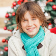Boy Smiling Against Christmas Tree — Stock Photo