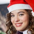 Beautiful Woman Wearing Santa Hat In Christmas Store — Stock Photo