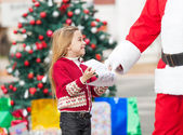 Santa Claus Taking Wish List From Girl — Stock Photo