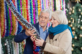 Couple Selecting Tinsels At Store — Stock Photo