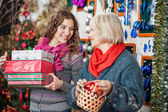 Beautiful Mother And Daughter In Christmas Store — Stock Photo