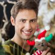 Man Holding Stuffed Toy In Christmas Store — Stock Photo