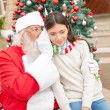 SantClaus Whispering In Girl's Ear — Stock Photo #35260407