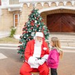 Sant Claus And Girl Looking At Each Other — Stock Photo #35260755