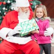 Girl Taking Present From Santa Claus — Stock Photo
