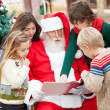 Santa Claus And Children Reading Book — Stock Photo