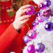 Owner Decorating Christmas Tree With Balls — Stock Photo