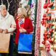Senior Couple At Christmas Store — Stock Photo