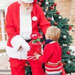 Santa Claus Giving Gift To Boy — Stock Photo #35264003