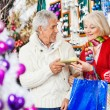 Couple Holding Present At Christmas Store — Stockfoto