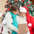 Boy Showing Digital Tablet To Santa Claus — Stock Photo