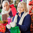 Happy Woman Shopping Presents With Tired Man — Stockfoto