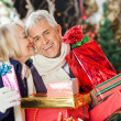 Woman About To Kiss Man Holding Presents — Foto Stock