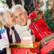 Woman About To Kiss Man Holding Presents — Stock Photo