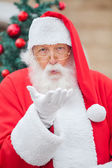 Santa Claus Blowing Kiss Outdoors — Stock Photo