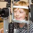 Boy Undergoing Eye Examination Test With Slit Lamp — Stock Photo