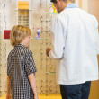 Optometrist And Boy Choosing Eyewear In Store — Stock Photo