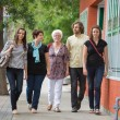 Friends Walking Together On Pavement — Stock Photo