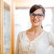 Female Customer Wearing Glasses In Store — Stock Photo #35289129