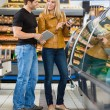 Couple Checking Ingredients Of Product At Butcher's Shop — Stock Photo #35289549