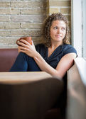 Woman Looking Through Window In Cafeteria — Stock Photo