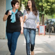 Friends With Disposable Coffee Cups Walking On Pavement — Stock Photo