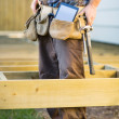 Carpenter With Tablet Computer And Hammer In Tool Belt — Stock Photo