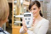 Optometrist Showing Pupilometer To Mature Woman — Stock Photo