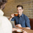 Smiling Man Having Coffee At Coffee Shop — Stock Photo