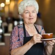 Waitress Holding Coffee Cup And Saucer In Cafe — Stock Photo