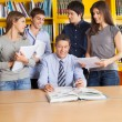 Male Teacher And Students In Library — Stock Photo