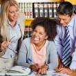 Cheerful Student With Teachers Standing Besides Her In Library — Stock Photo