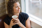 Thoughtful Woman With Coffee Mug In Cafe — Stock Photo