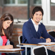 Student Sitting At Desk With Classmate In Classroom — Stock Photo