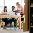 Librarian Assisting Students In Library — Stock Photo