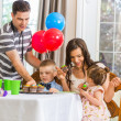 Family Eating Cupcakes At Birthday Party — Stock Photo