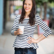 Woman Holding Coffee Cup Outdoors — Stock Photo