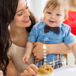 Stock Photo: Baby Boy And Mother With Birthday Cake On Table