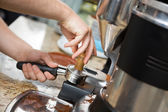 Barista Tamping Coffee — Stock Photo